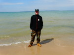 A counselor poses on a Lake Michigan beach.